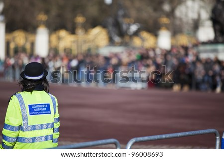 Community support police officer on duty. Daytime in public place outdoor