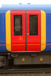 Commuter train door with access for disabled people