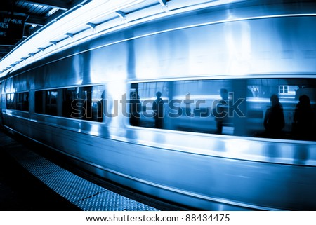 Commuters caught in the reflection of window as a metropolitan rail train goes by