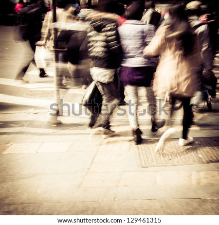 Commuters crossing at rush hour, blur motion