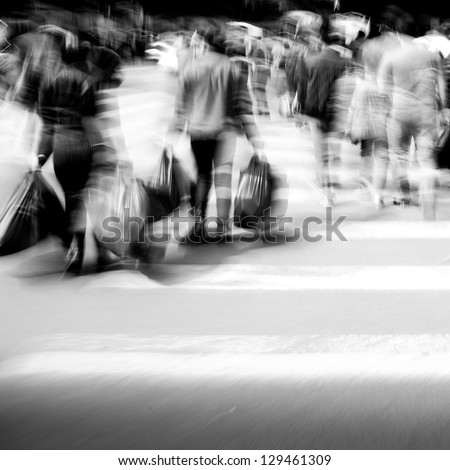 Commuters crossing at rush hour, blur motion, black and white #129461309