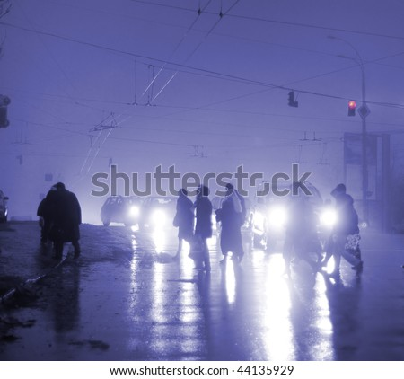 commuters crossing the street  during evening rush hour