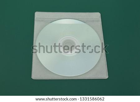 compact disc on green rubber mat. #1331586062