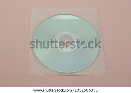 compact disc on pink paper. #1331586335