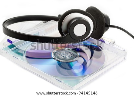 Compact Discs (CDs) with headphones on white - stock photo