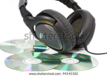 Compact Discs (CDs) with headphones on white