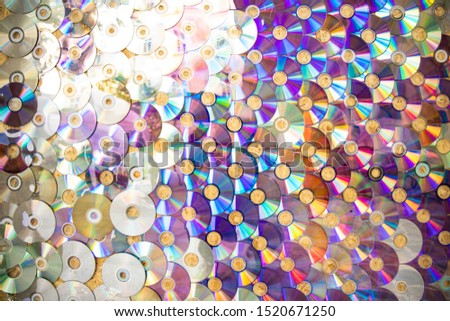 Compact discs colorful glares wall background outdated technologies objects