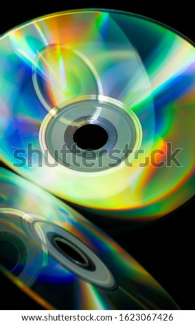 compact-discs on a black background