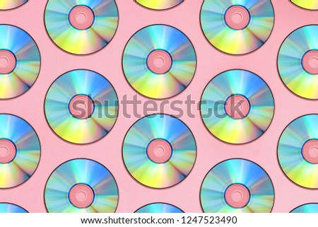 Compact discs on a pink background #1247523490