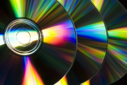 Compact discs raw reflecting ray of color