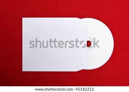 Compact disk with empty jacket on red background