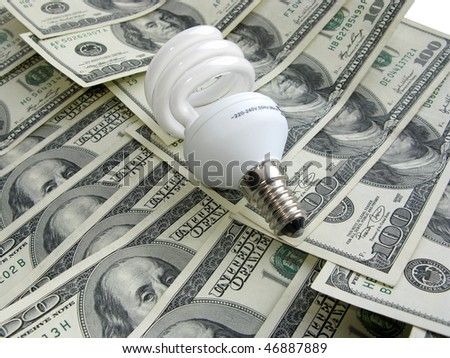 Compact fluorescent bulb against dollar background