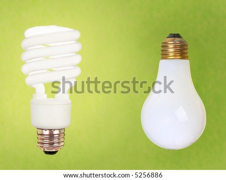 compact fluorescent energy saving environment friendly and old fashioned regular bulb on green background