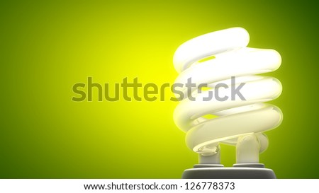 Compact fluorescent lamp. Green background, ecological metaphor.