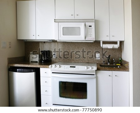 Compact kitchenette in hotel suite