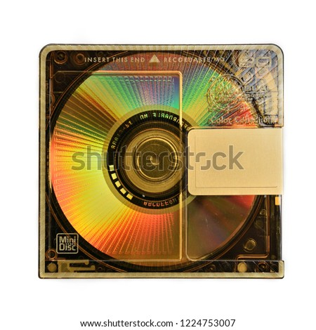 Compact rewritable Mini Disc- MD for digital recording released in the 90s on an isolated white background.