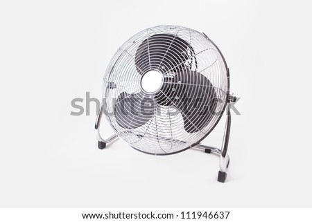 Compact table top electric cooler fan isolated on white