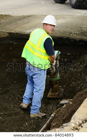 Compacting the backfill in the excavation hole to repair a 12 inch water main failure on Harvard Ave in Roseburg OR