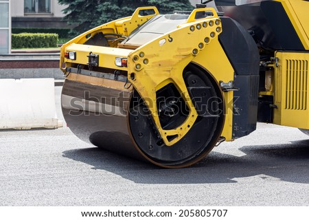 Compaction of asphalt surface by vibratory rollers machines during road construction works