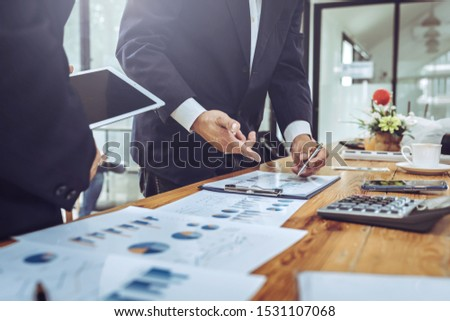 Company employees using tablet with business chart meeting room colleagues financial charts. stock photo