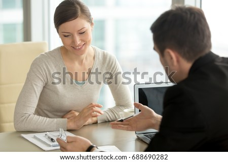 Company executive coaching young personal secretary assistant, team leader or senior manager explaining work duties to junior, businessman telling contractual terms or deal details to female partner #688690282