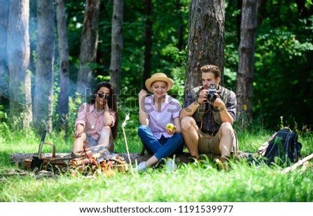 Company hikers relaxing at picnic forest background. Spend great time on weekend. Halt for snack during hiking. Camping and hiking. Company friends relaxing and having snack picnic nature background.