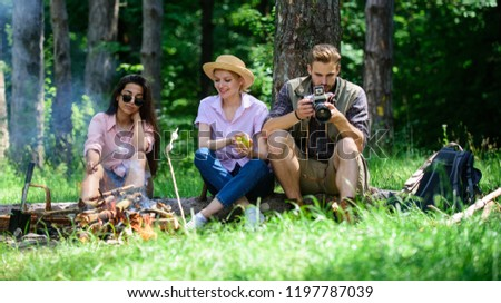 Company hikers relaxing at picnic forest background. Spend great time on weekend. Halt for snack during hiking. Company friends relaxing and having snack picnic nature background. Camping and hiking.
