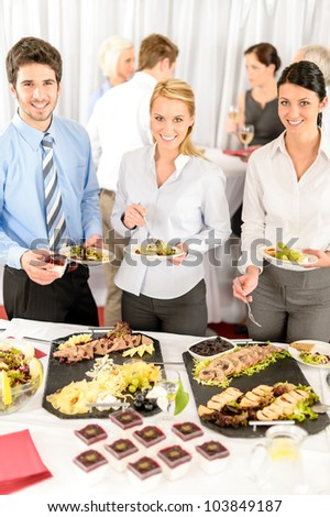 Company meeting catering smiling business people eat buffet appetizers