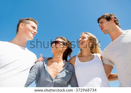 Company of young people on the beach #372968734