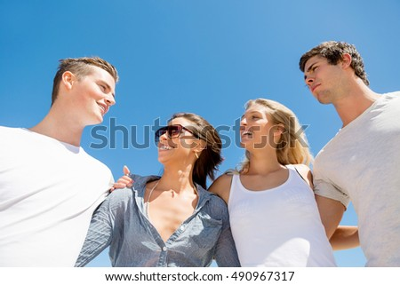 Company of young people on the beach #490967317