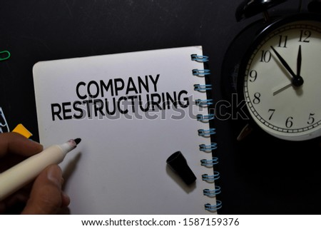 Company Restructuring write on book isolated on office desk. Foto d'archivio ©