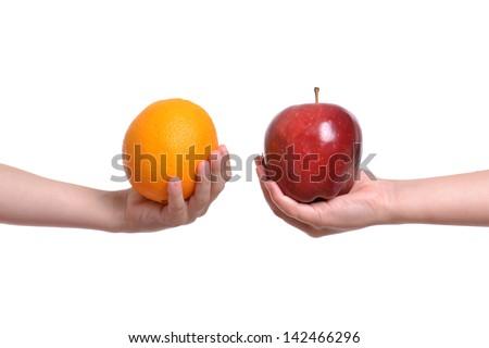 compare apple to orange white background ストックフォト ©