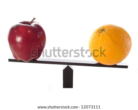 Comparing apples to heavy oranges on a balance beam isolated on white.