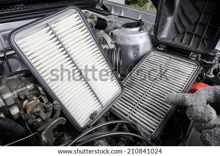 comparison between new and used air filter for car, automotive spare part  #210841024