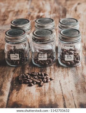 Comparison of Various Indonesia Arabica Coffee Bean In The Jar For Tasting. Coffee Beans Label are Toraja Kalosi, Bali Kintamani and Aceh Gayo