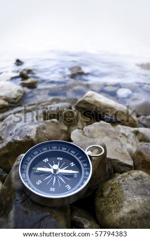 compas on the coast with cobbles - stock photo