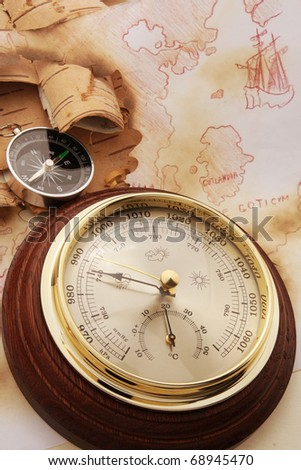 Compass and barometer on old chart of North Europe