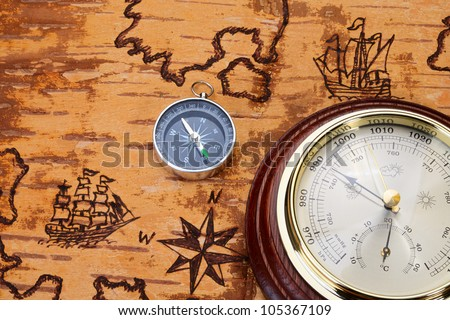 Compass and barometer on sea chart on the order of olden time