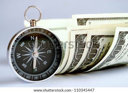 compass and money on the table