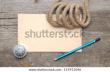 Compass and rope on the old paper background