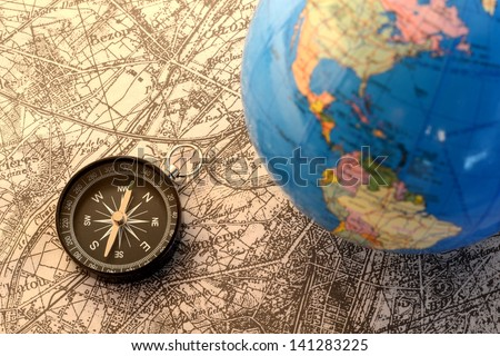Compass and terrestrial globe on old map