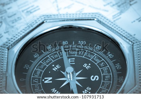 Compass Black with Green Symbols on Dial on map