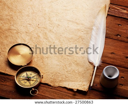 Compass, Inkwell and feather on a background of the empty form for the letter