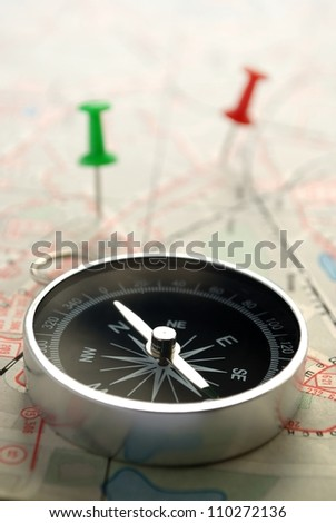 compass map and pushpin on the table
