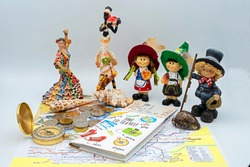 compass, map, money, documents and souvenirs from different countries on the traveler's table