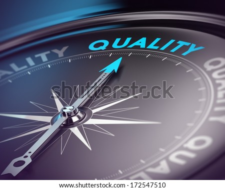 Compass needle pointing the blue text. Blue and black tones with blur effect and focus on the main word. Concept for quality assurance management.