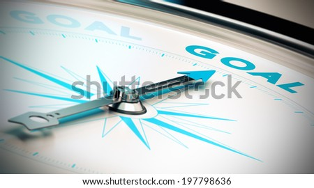 Compass, needle pointing the word goal, blue and beige tones. Illustration of objectives attainment or motivation, concept.  - stock photo