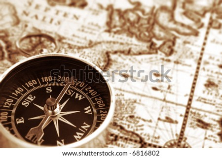 compass on a map - stock photo