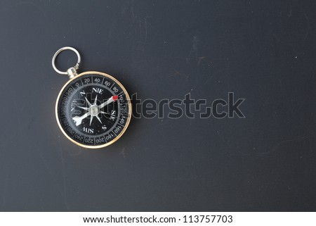 compass on  blackboard background