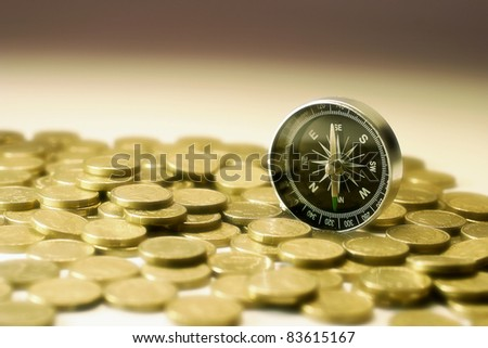 Compass on Coins in Warm Tone